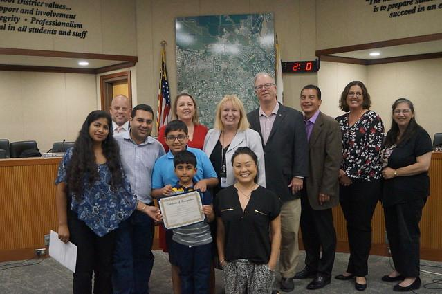 Aryav with family, board, and superintendent