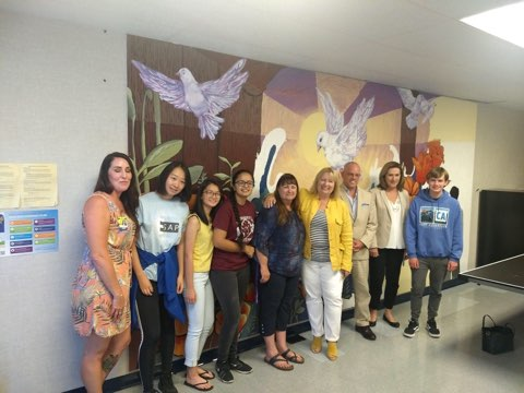 Superintendent Dr. Kemp and students with mural