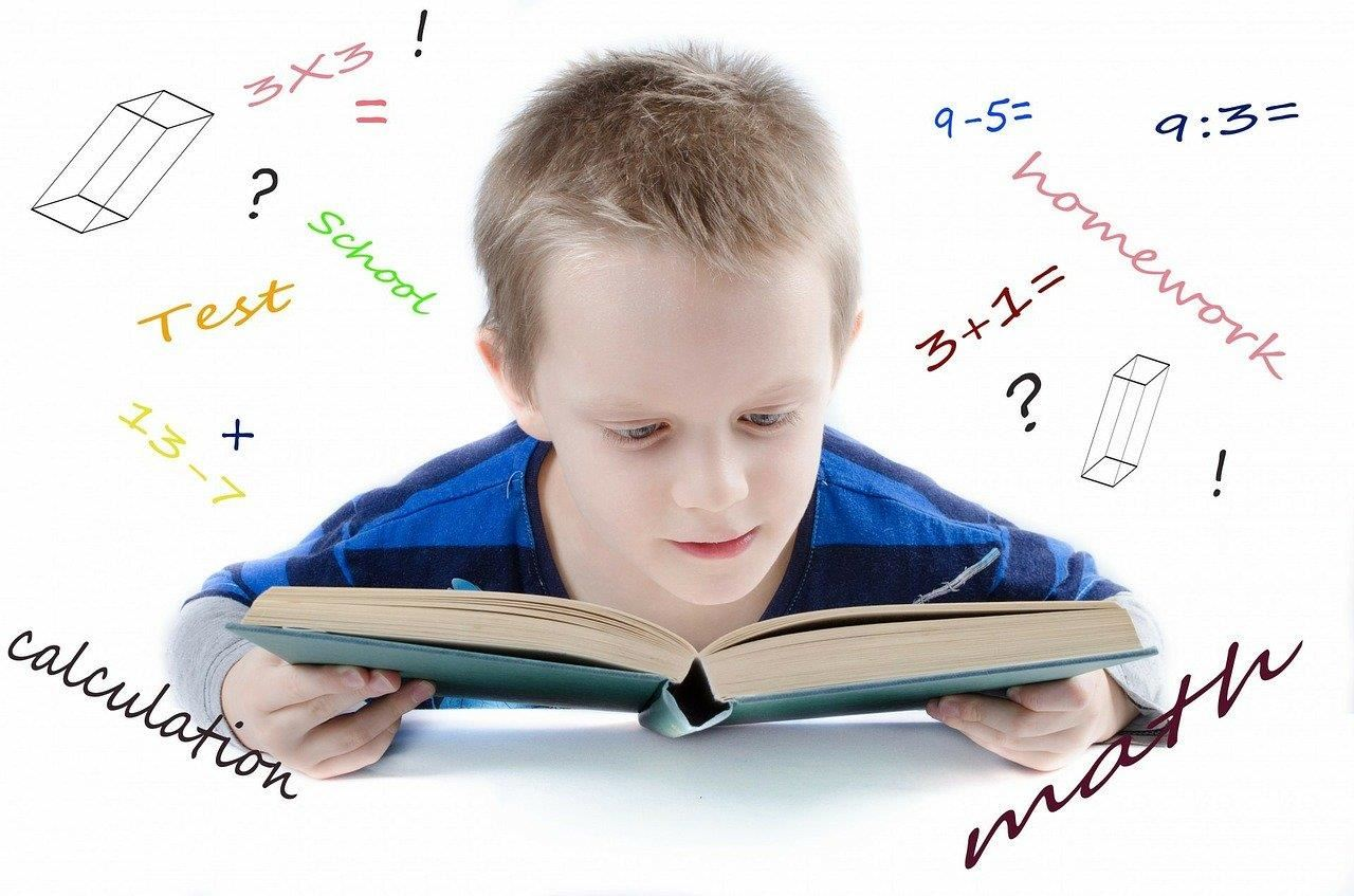 student reading with mathematics images all around him